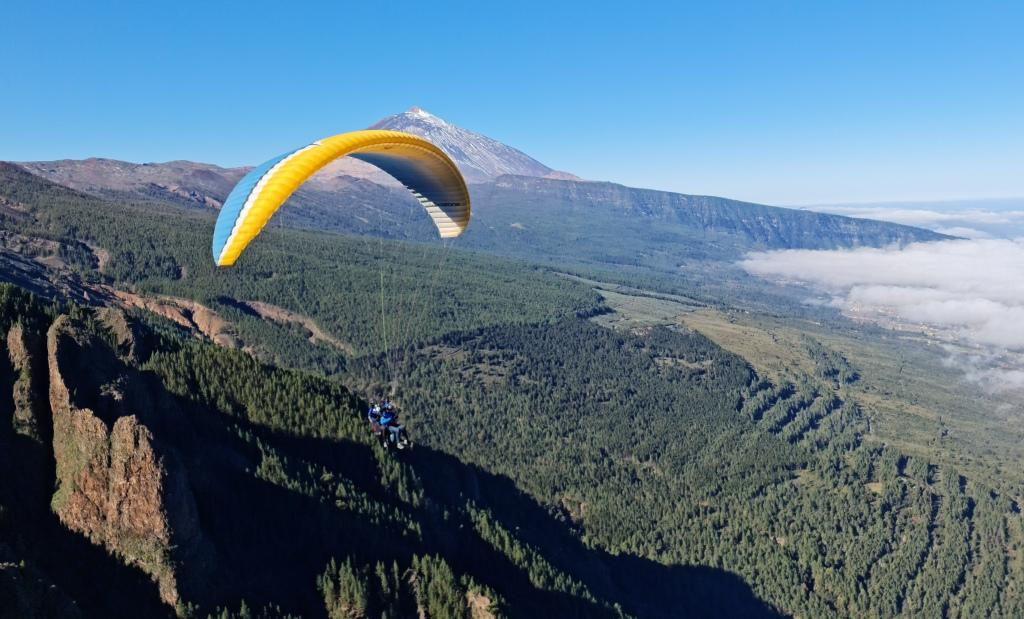 What is glide range in paragliding?